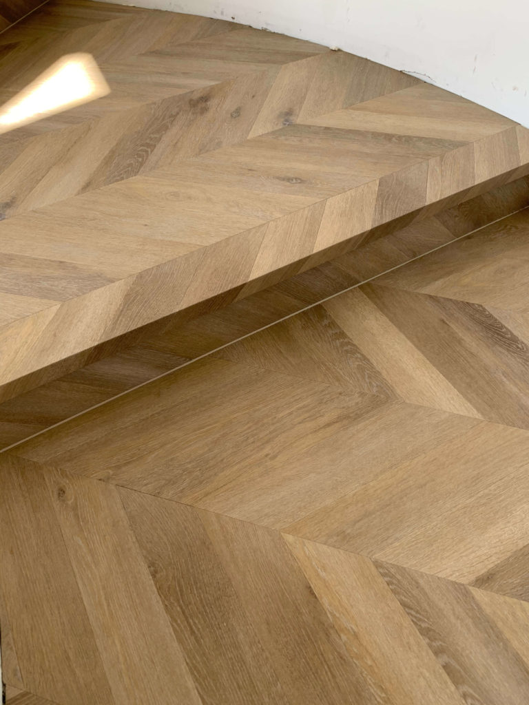 Parquetry SPC landing on curved wall